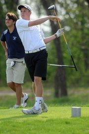 Free State High's Alex Green takes a swing on hole No. 11 on Wednesday, March 28, 2012, at Eagle Bend Golf Course.