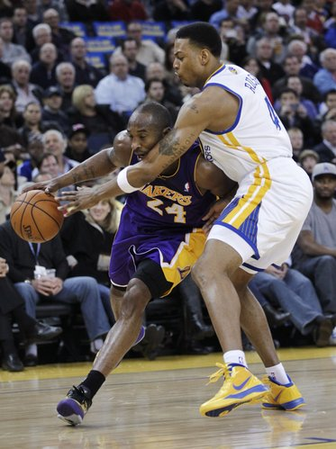 Los Angeles Lakers guard Kobe Bryant (24) is closely covered by Golden State Warriors guard Brandon Rush(4) in the first quarter of an NBA basketball game in Oakland, Calif., Tuesday, March 27, 2012.