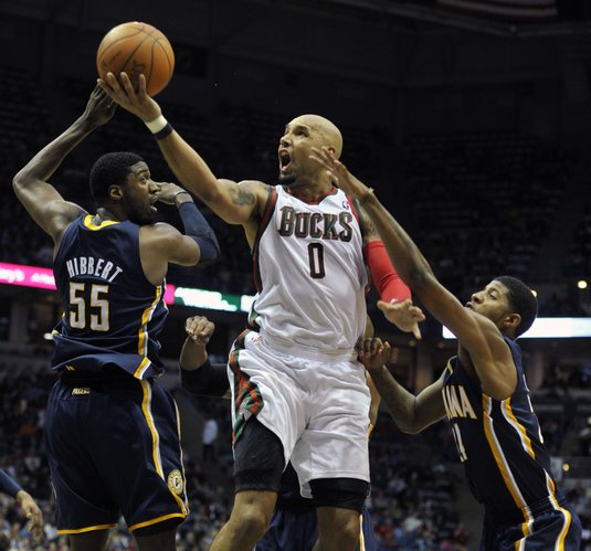 Indiana Pacers' Roy Hibbert (55) and Paul George defend as Milwaukee Bucks' Drew Gooden (0) drives to the basket during the first half of an NBA basketball game on Saturday, March 24, 2012, in Milwaukee.