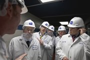 Craig Letch, director of food quality and assurance for Beef Products Inc. (BPI), left, leads a tour of governors from left: Iowa Gov. Terry Branstad, Kansas Gov. Sam Brownback, South Dakota Lt. Gov. Matt Michels, Nebraska Lt. Gov. Rick Sheehy and Texas Gov. Rick Perry, Thursday, March 29, 2012, through Beef Products Inc.'s plant in South Sioux City, Neb., where the beef product is made. The governors of Iowa, Texas and Kansas and lieutenant governors of Nebraska and South Dakota toured the plant to show their support for the company and the several thousand jobs it creates in Nebraska, Iowa, Kansas, South Dakota and Texas.