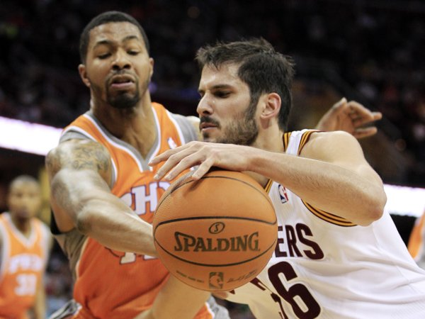 Cleveland Cavaliers' Omri Casspi, right, of Israel, drives past Phoenix Suns' Markieff Morris during the second quarter in an NBA basketball game, Sunday, March 25, 2012, in Cleveland.