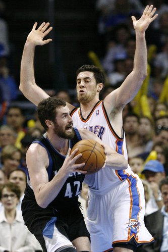 Minnesota Timberwolves center Kevin Love, left, goes up for a shot as Oklahoma City Thunder's Nick Collison, right, defends during the second half of an NBA basketball game in Oklahoma City, Friday, March 23, 2012. Oklahoma City won 149-140 in double overtime.