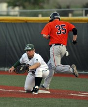 Free State first baseman Montana Samuels gets an out at first in the Firebirds' game against Olathe East on Thursday, March 29, 2012, at FSHS.