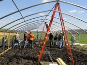 A high tunnel is constructed at Red Tractor Farm, 974 E. 850 Road. The farm hosted a high tunnel construction workshop on March 24 in conjunction with K-State Research and Extension and the Kansas Rural Center, with partial funding for the workshop provided by the Kansas Department of Agriculture.