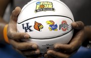 A fan waits for autographs on a souvenir Final Four basketball during a day of practices at the Superdome on Friday, March 30, 2012.