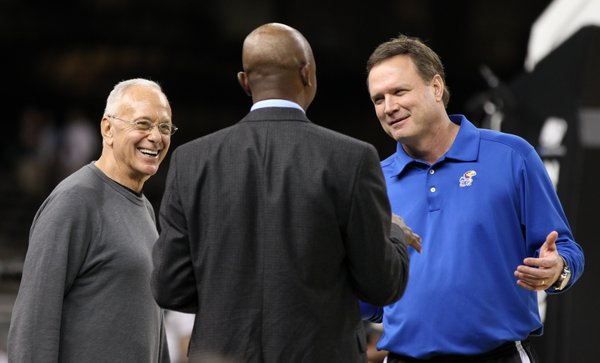 Former Kansas coach Larry Brown, left, laughs as he and Kansas head coach Bill Self talk with CBS commentator Greg Anthony during a day of practices at the Superdome on Friday, March 30, 2012.