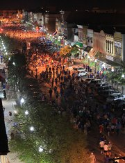In this photo taken from the top of Weaver's Department Store, looking north, thousands of Jayhawk fans fill Massachusetts Street on Saturday, March 31, 2012, after KU defeated Ohio State, 64-62, to advance to the national championship game against Kentucky.