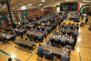 More than two hundred law enforcement personnel eat dinner at the community center, Saturday, March 31, 2012, before going to the streets for crowd control during KU's national semifinal game against Ohio State.