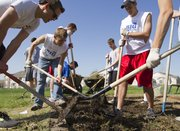 Members of the Sigma Nu fraternity spend the morning plowing a garden at One of a Kind daycare center Saturday, March 31, 2012. The group was taking part in The Big Event, in which KU students volunteer all across Lawrence doing things such as painting, gardening and weeding.