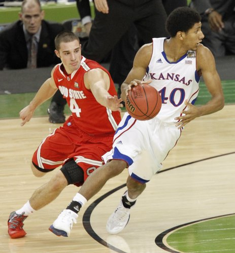 Ohio State's Aaron Craft pursues Kevin Young in the first half of KU's semifinal game against Ohio State on Saturday, March 31, at the Superdome in New Orleans.