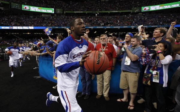 Kansas guard Tyshawn Taylor leads the Jayhawks to the court prior to tipoff against Ohio State at the Superdome on Saturday, March 31, 2012.