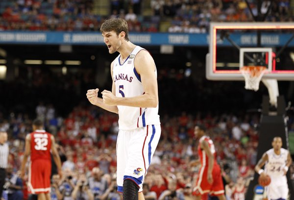Kansas center Jeff Withey pumps his fist after a Jayhawk bucket to end the half against Ohio State during the first half on Saturday, March 31, 2012 at the Superdome.