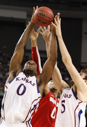 Kansas big men Thomas Robinson (0) and Jeff Withey (5) grab a rebound from Ohio State forward Jared Sullinger during the second half on Saturday, March 31, 2012 at the Superdome.