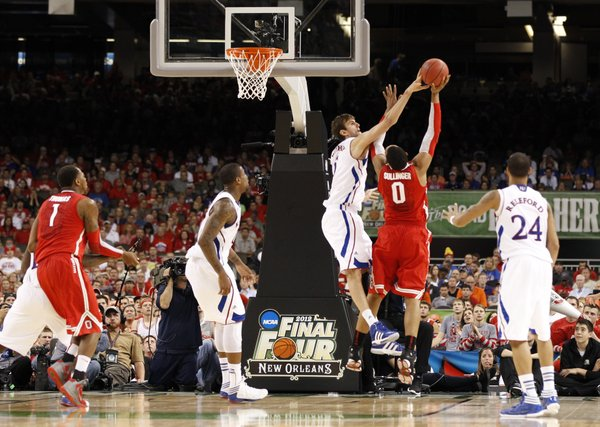 Kansas center Jeff Withey blocks a shot by Ohio State forward Jared Sullinger during the second half on Saturday, March 31, 2012 at the Superdome.