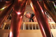 Bill Klimas, a Reuter Organ employee, adjusts organ pipes March 31 at First Presbyterian Church, 2415 Clinton Parkway. The church spent seven years repairing and updating its organ, and will be unveiled for the first time Easter Sunday.