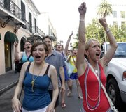 KU fans follow a KU parade through the French Quarter, Sunday, April 1, that featured the KU band and cheer squad.