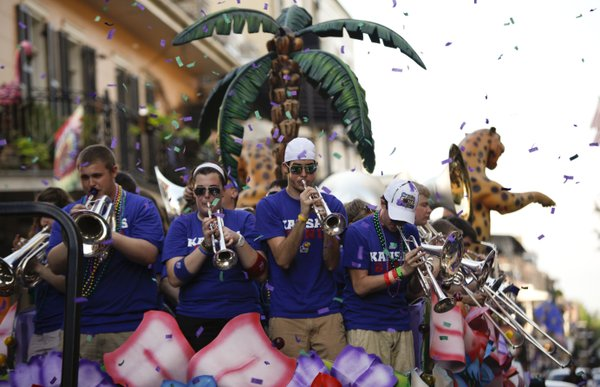 Confetti flies as members of the basketball band perform during a parade around the French Quarter on Sunday, April 1, 2012 in New Orleans.