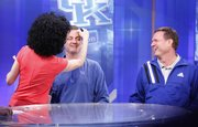 Kansas head coach Bill Self smiles at Kentucky head coach John Calipari as the two sit for makeup before their joint CBS interview on Sunday, April 1, 2012 at the Superdome.