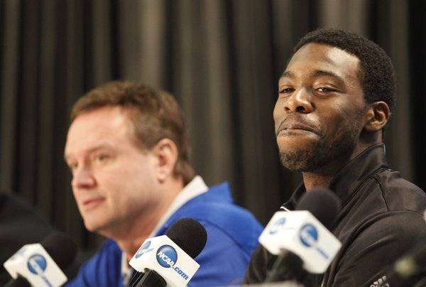 Kansas guard Elijah Johnson smiles as the team and head coach Bill Self sit during a press conference on Sunday, April 1, 2012 at the Superdome.