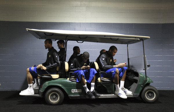 The Kansas starting five relax on a golf cart while waiting to be shuttled to breakout interviews on Sunday, April 1, 2012 at the Superdome.
