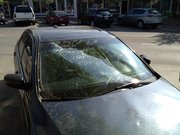 On Sunday morning, a gray Honda Accord parked in the 800 block of Massachusetts Street had a shattered windshield and a crushed roof, possibly from Saturday night's celebration.