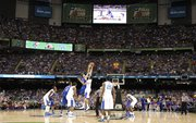 Kansas center Jeff Withey and Kentucky forward Anthony Davis go up for the opening tipoff of the national championship on Monday, April 2, 2012 in New Orleans.