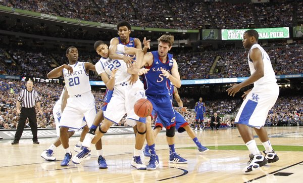 Kansas players Jeff Withey (5) and Kevin Young wrestle for a loose ball with Kentucky players Doron Lamb (20) Anthony Davis (23) and Darius Miller during the first half of the national championship on Monday, April 2, 2012 in New Orleans.