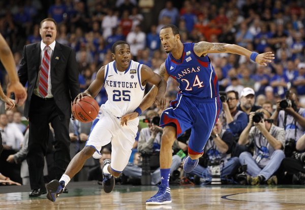 Kansas guard Travis Releford looks to foul Kentucky guard Marquis Teague during the second half of the national championship on Monday, April 2, 2012 in New Orleans.
