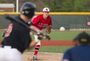 Lawrence High junior starting pitcher Adam Rea delivers a pitch to Shawnee Mission Northwest senior Austin Howard on Tuesday, April 3, 2012, at LHS.