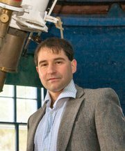 Idan Ginsburg, shown with a historic telescope at Dartmouth College in Hanover, N.H., is a 1994 graduate of Lawrence High School.