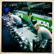 Journal-World photographer Nick Krug, right, sets up one of several remote cameras in the Superdome in New Orleans for the NCAA men's basketball championship game Monday.
