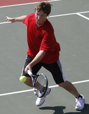 Lawrence High boys tennis player Thomas Irick competes during the Lions' quadrangular on Thursday, April 5, 2012, at LHS.