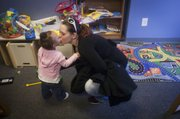Heather Miller, 22, gets a kiss from her 17-month-old daughter, Shylin James. Miller and her daughter are residents at The Salvation Army Family Service Center in Olathe.