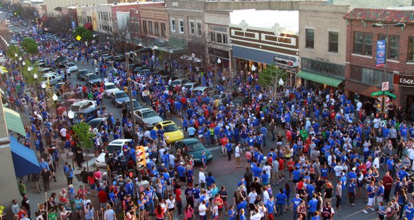 Fans hit Mass. Street to celebrate Kansas&#39; victory over North Carolina to earn a trip to the Final Four.