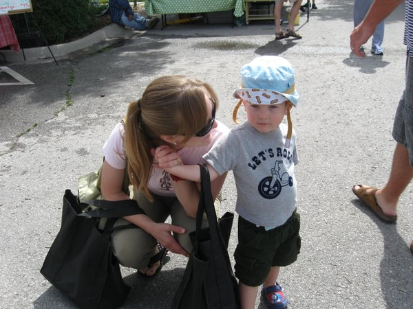 The kiddo and me at the Saturday Lawrence Farmers' Market last year.
