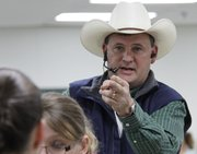 Auctioneer Mark Elston, owner of Elston Auction Company, Baldwin City, calls an auction Saturday, April 7, 2012, at the Douglas County Fairgrounds, 2110 Harper St.