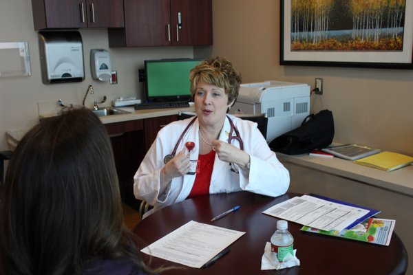 Kathleen Dalton, advanced practice registered nurse, explains the results of a heart assessment to Lawrence Journal-World health reporter Karrey Britt on March 29, 2012, at Kansas University Hospital&#39;s Adelaide C. Ward Women&#39;s Heart Health Center. More than 900 people have had a heart assessment through the hospital&#39;s A Change of Heart program, which was started five years ago. Of those, 90 percent had at least one risk factor for heart disease.