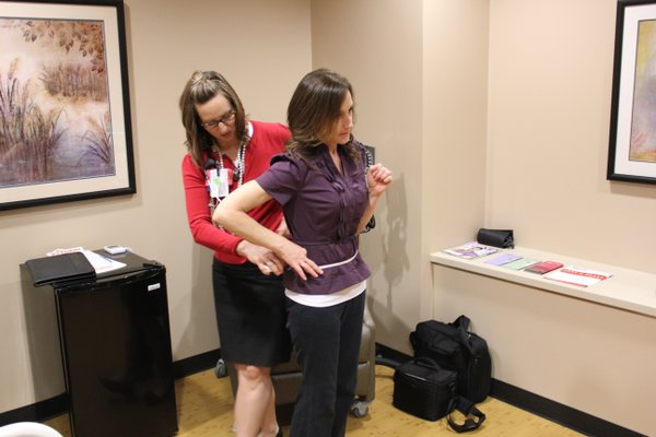 Sarah Sanders, cardiovascular nurse clinician, measures the waist of Lawrence Journal-World health reporter Karrey Britt during a heart health screening March 29, 2012, at Kansas University Hospital's Adelaide C. Ward Women's Heart Health Center. The screening was part of the hospital's A Change of Heart program. Britt learned she wasn't at risk for heart disease.