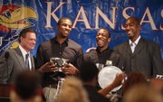 Teammates Thomas Robinson and Tyshawn Taylor have a laugh with head coach Bill Self and former assistant Danny Manning after the players were presented as co-recipients of the Mr. Jayhawk Danny Manning Award for the 2011-12 season, during the Men's Basketball Banquet on Monday, April 9, 2012 at the Holidome.