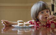 Tommy Lintner, 4, enjoys some of his mom's cranberry orange pattycakes.