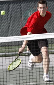 Lawrence High senior Randy Walter returns a volley during during the city showdown tennis dual against Free State on Tuesday, April 10, 2012, at FSHS.