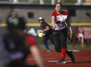 Lawrence High pitcher Megan Sumonja delivers to the mound during the fifth inning against Olathe South on Tuesday, April 10, 2012 at Lawrence High.