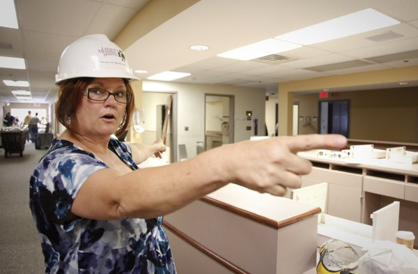 Registered nurse and medical unit director, Debbie Rector, points to various renovations that will be made to the second floor medical unit during a tour on Thursday, April 12, 2012, at Lawrence Memorial Hospital. Proceeds from LMH Endowment Association's upcoming Hearts of Gold Ball will help pay for upgrades in the unit, which includes 28 patient rooms.