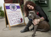 "Raven Rajani, pictured with her dog Shakti, will open her business ""Lucky Paws Bakery"" this Friday, where she will sell her homemade dog treats and other items. Her new store is located at 729 1/2 Mass."