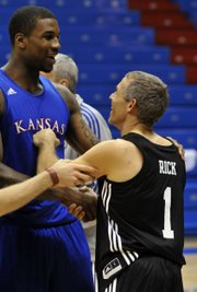 Kansas forward Thomas Robinson jokes with Rick Schnall of New York before a scrimmage at the Bill Self Basketball Experience fantasy camp on Thursday, April 12, 2012 at Allen Fieldhouse.