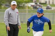 Former Lawrence High School baseball coach Ron Garvin watches as his grandson Peyton Garvin, 12, rounds second base during a practice Saturday, April 7, 2012 at the YSI sports complex. Garvin helps coach his grandson's baseball team.