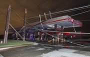 "Downed power lines kept some people trapped in a Quiktrip at Rock and Pawnee in Wichita, Kansas after a tornado swept through the area Saturday night April 14, 2012. Tornadoes were spotted across the Midwest and Plains on Saturday as an outbreak of unusually strong weather seized the region, and forecasters sternly warned that ""life-threatening"" weather could intensify overnight."