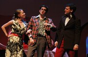 "From left, Sarah Bodle, Michael Cooper and Alex Goering in University Theatre&squot;s ""Merrily We Roll Along."""