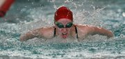 Lawrence High's Miranda Rohn competes in the 200 medley relay on Tuesday, April 17, 2012, at LHS.