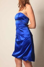 A former bridesmaid dress is shortened and given a bubble hem, making it wearable to a future formal event.
